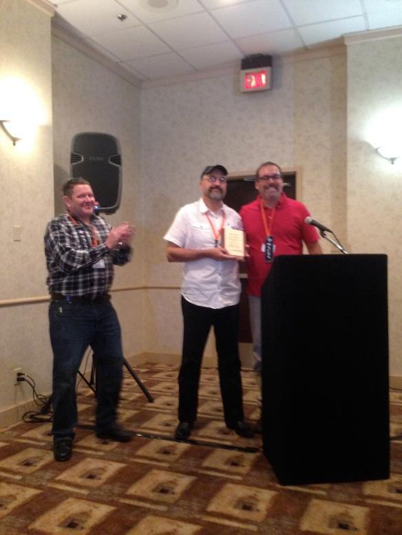 Jack, Chris, Jeff giving the award
