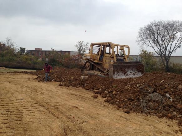 large bulldozer leveling  stuff
