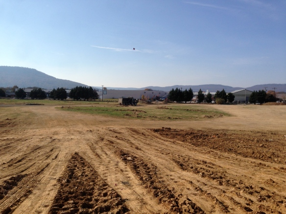 atop the 9' berm. Hard to tell, but it is pretty slope-y.  Broken truck in background for scale...